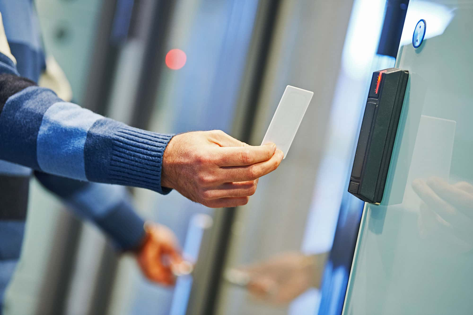 Business man using access control systems swipe card