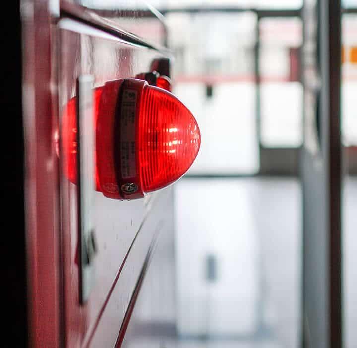 Red Commercial Fire Alarm siren in corridor